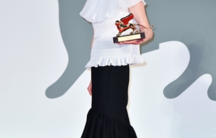 VENICE, ITALY - SEPTEMBER 02: Tilda Swinton poses on the red carpet with the Golden Lion Lifetime achievement award after the Opening Ceremony during the 77th Venice Film Festival at  on September 02, 2020 in Venice, Italy. (Photo by Stephane Cardinale - Corbis/Corbis via Getty Images)