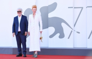 """VENICE, ITALY - SEPTEMBER 03: Director Pedro Almodóvar and Tilda Swinton walk the red carpet ahead of the movie """"The Human Voice"""" and """"Quo Vadis, Aida?"""" at the 77th Venice Film Festival at  on September 03, 2020 in Venice, Italy. (Photo by Daniele Venturelli/WireImage,)"""