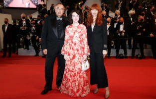 """CANNES, FRANCE - JULY 10: Alexander Rodnyansky, Milana Aguzarova and Kira Kovalenko attend the """"Flag Day"""" screening during the 74th annual Cannes Film Festival on July 10, 2021 in Cannes, France. (Photo by Vittorio Zunino Celotto/Getty Images for Kering)"""