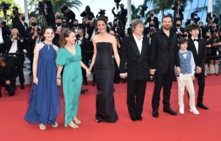"""CANNES, FRANCE - JULY 14: (L to R) Juliette Benveniste, Anne-Sophie Bowen-Chatet, Vicky Krieps, Mathieu Amalric, Arieh Worthalter, Sacha Ardilly and Aurele Grzesik attend the """"A Felesegam Tortenete/The Story Of My Wife"""" screening during the 74th annual Cannes Film Festival on July 14, 2021 in Cannes, France. (Photo by Dominique Charriau/WireImage)"""