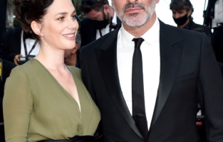 """CANNES, FRANCE - JULY 17: Nathalie Pechalat and Jean Dujardin attend the final screening of """"OSS 117: From Africa With Love"""" and closing ceremony during the 74th annual Cannes Film Festival on July 17, 2021 in Cannes, France. (Photo by Dominique Charriau/WireImage)"""