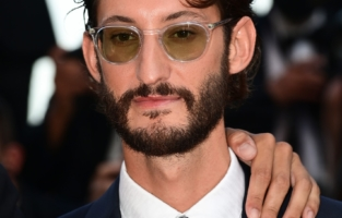 """CANNES, FRANCE - JULY 17:  Pierre Niney attends the final screening of """"OSS 117: From Africa With Love"""" and closing ceremony during the 74th annual Cannes Film Festival on July 17, 2021 in Cannes, France. (Photo by Pascal Le Segretain/Getty Images)"""