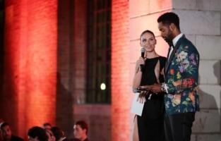 VENICE, ITALY - SEPTEMBER 10: (L-R) Nina Senicar and Jay Ellis speak on stage during the amfAR Venice gala 2021 on September 10, 2021 in Venice, Italy. (Photo by Kennedy Pollard/amfAR/Getty Images for amfAR)