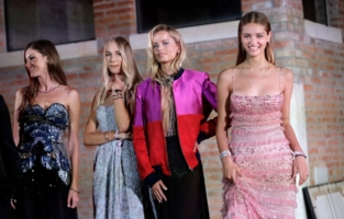 VENICE, ITALY - SEPTEMBER 10: (L-R) Valery Kaufman, Valentina Shcherbenko, Frida Aasen and Anna Castellini Baldissera on stage during the auction at the amfAR Venice gala 2021 on September 10, 2021 in Venice, Italy. (Photo by Claudio Lavenia/amfAR/Getty Images for amfAR)