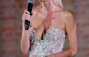 VENICE, ITALY - SEPTEMBER 10: Leonie Hanne speaks on stage during the auction at the amfAR Venice gala 2021 on September 10, 2021 in Venice, Italy. (Photo by Claudio Lavenia/amfAR/Getty Images for amfAR)